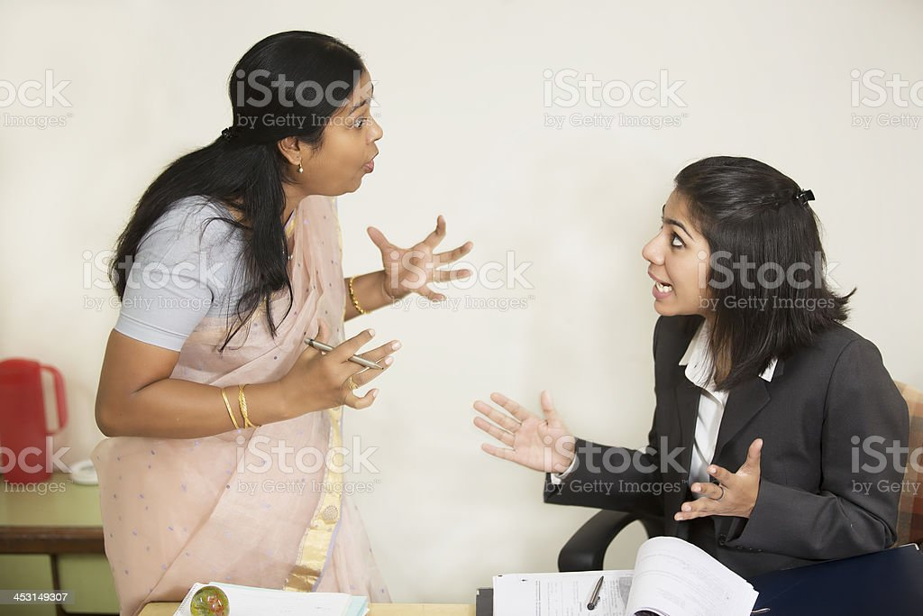 Two Indian Businesswoman fighting and screaming stock photo