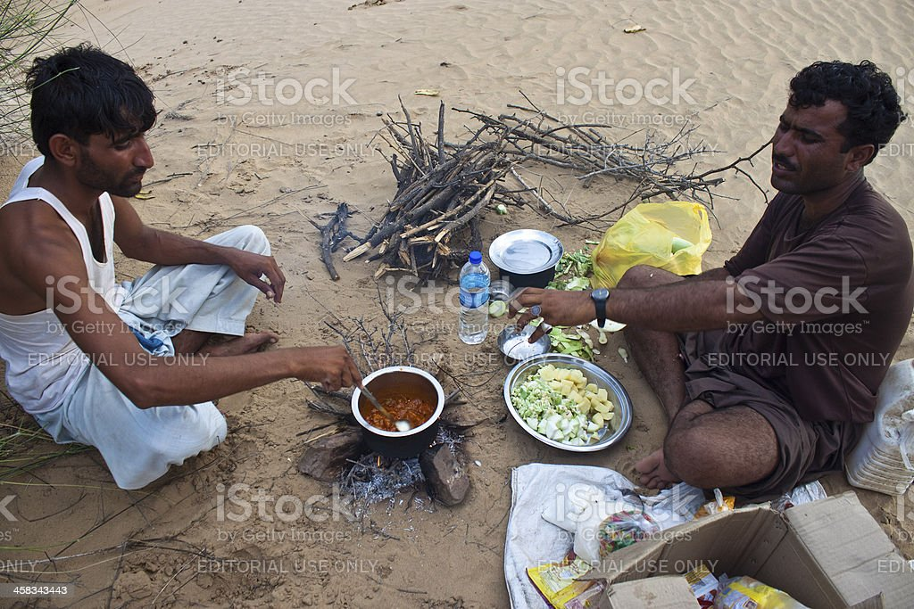 Two indian men cook local meals stock photo
