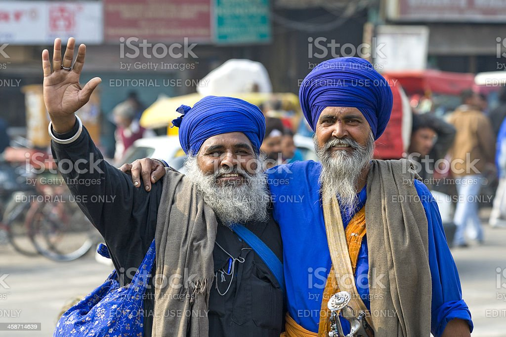 Two indian Sikh men in traditional costume stock photo