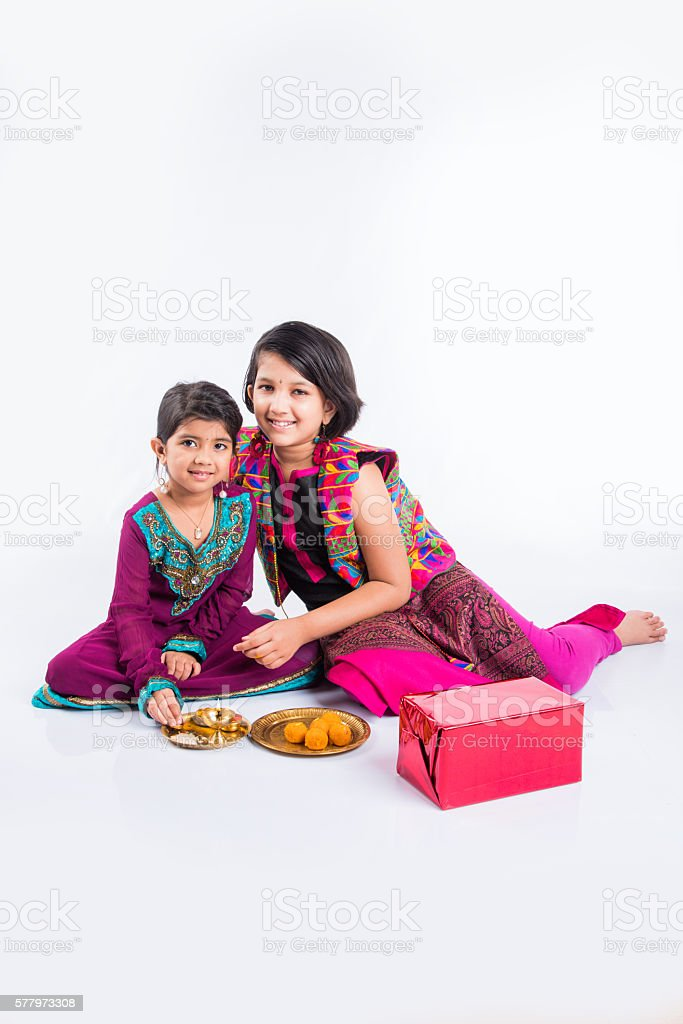 two indian small girls preparing puja thali stock photo