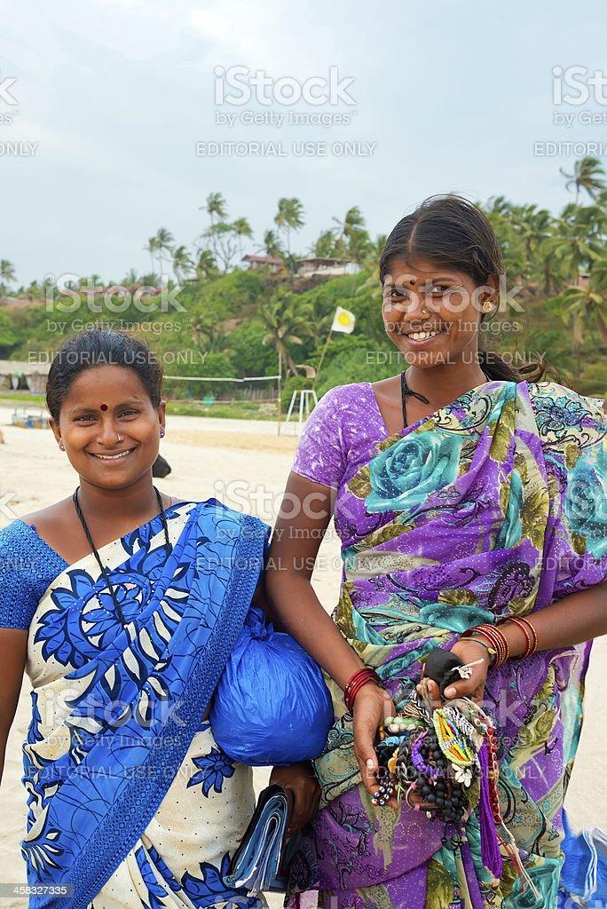 Two Indian women sell souvenirs on the beach Vagator Goa royalty-free stock photo