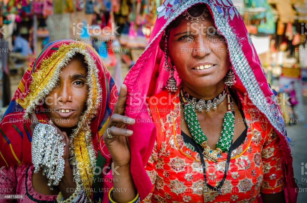 Two Indian women selling souvenirs stock photo