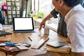 two interior designers having a team meeting using digital tablet