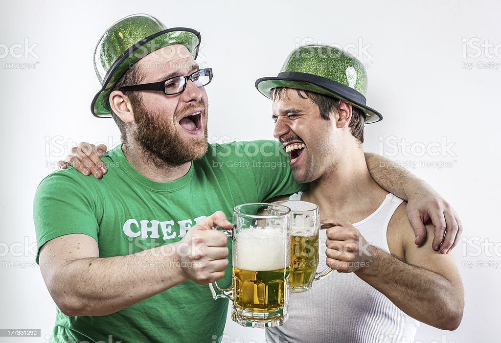 Two Irish men celebrating, singing on St. Patrick's Day stock photo