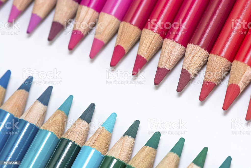 Two Isolated Opposite Rows with Colorful Crayons stock photo