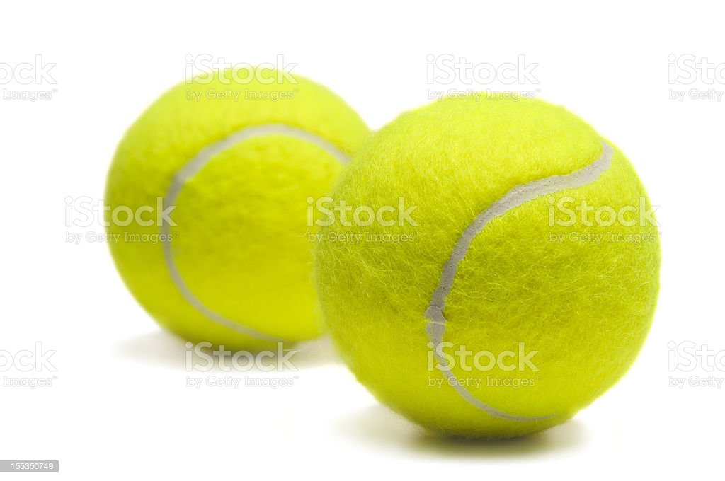 Two isolated yellow tennis balls royalty-free stock photo