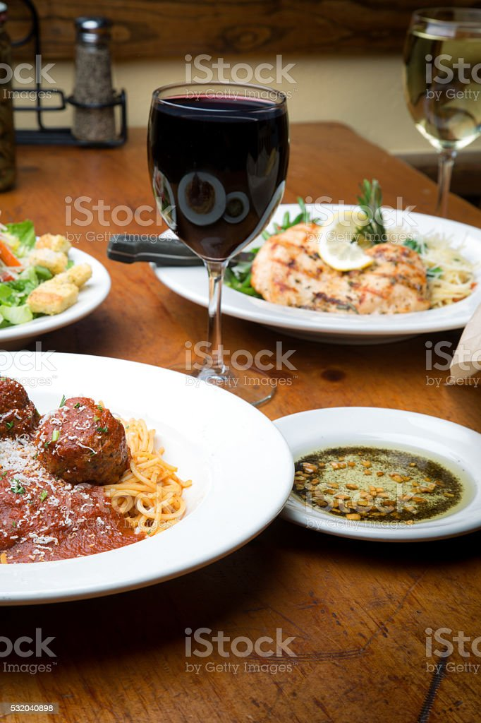Two Italian Entrees With Wine stock photo