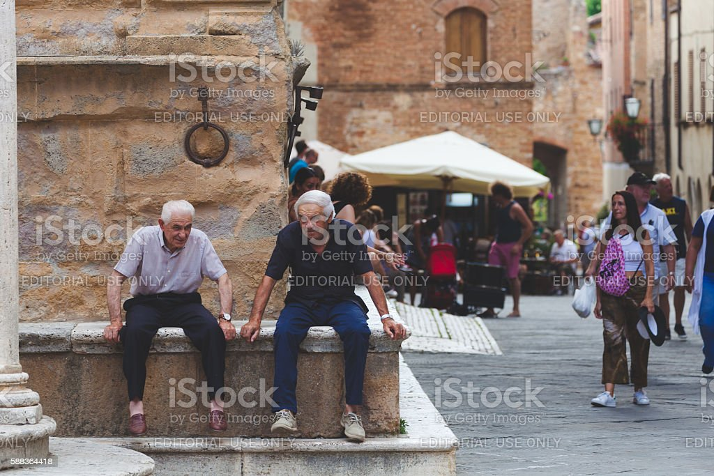 two italian senior men sitting and talking stock photo