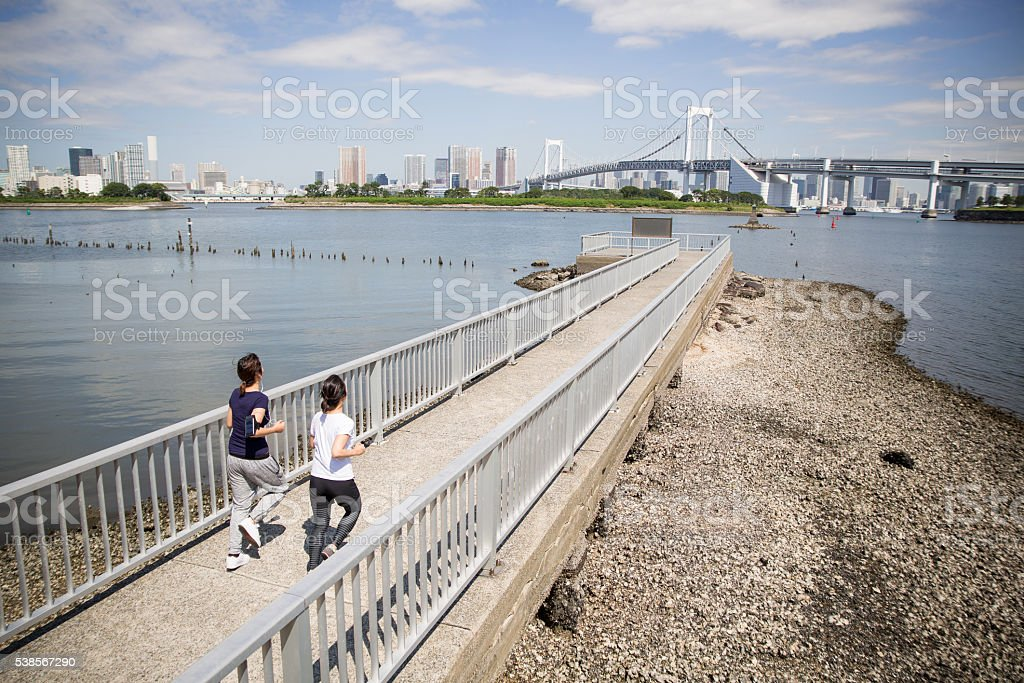 Two Japanese ladies running together in the morning stock photo