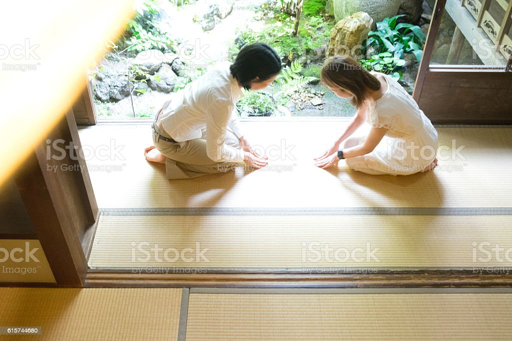 Two Japanese women bowing with respect stock photo