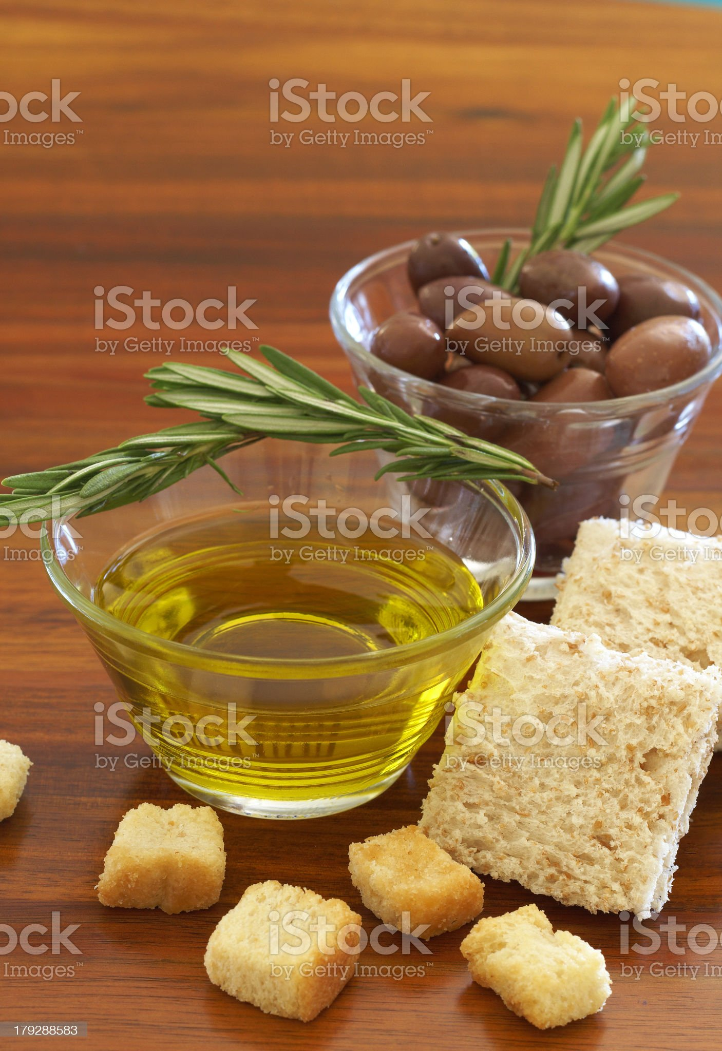 Two jars of black olives and olive oil royalty-free stock photo