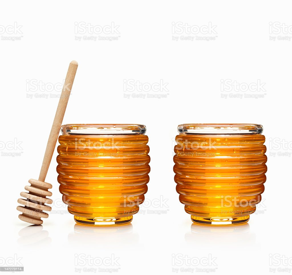 Two jars of honey and a dipper stock photo