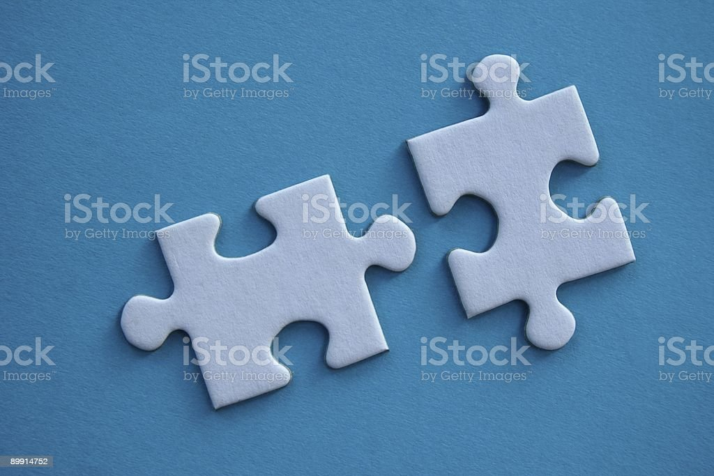 Two jigsaw puzzle pieces stock photo