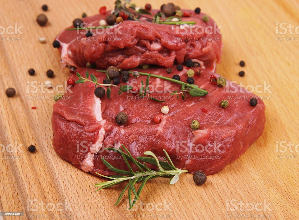 Two juicy beef steak with spices and herbs royalty-free stock photo