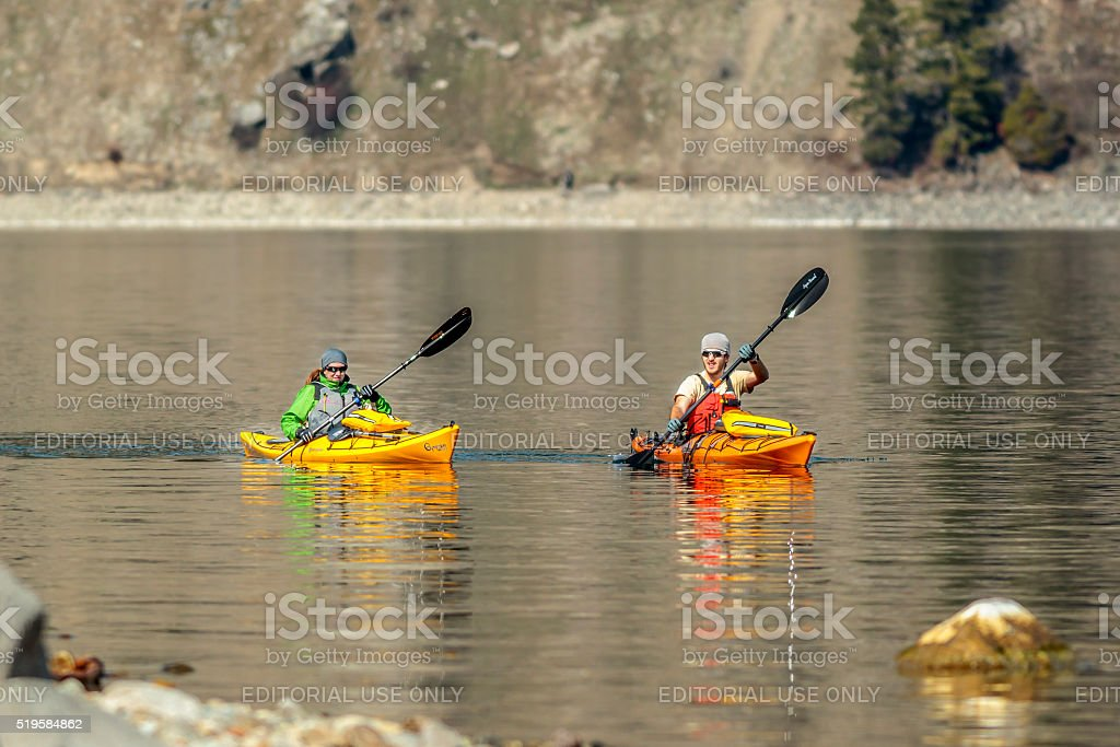 Two Kayakers in lake. stock photo
