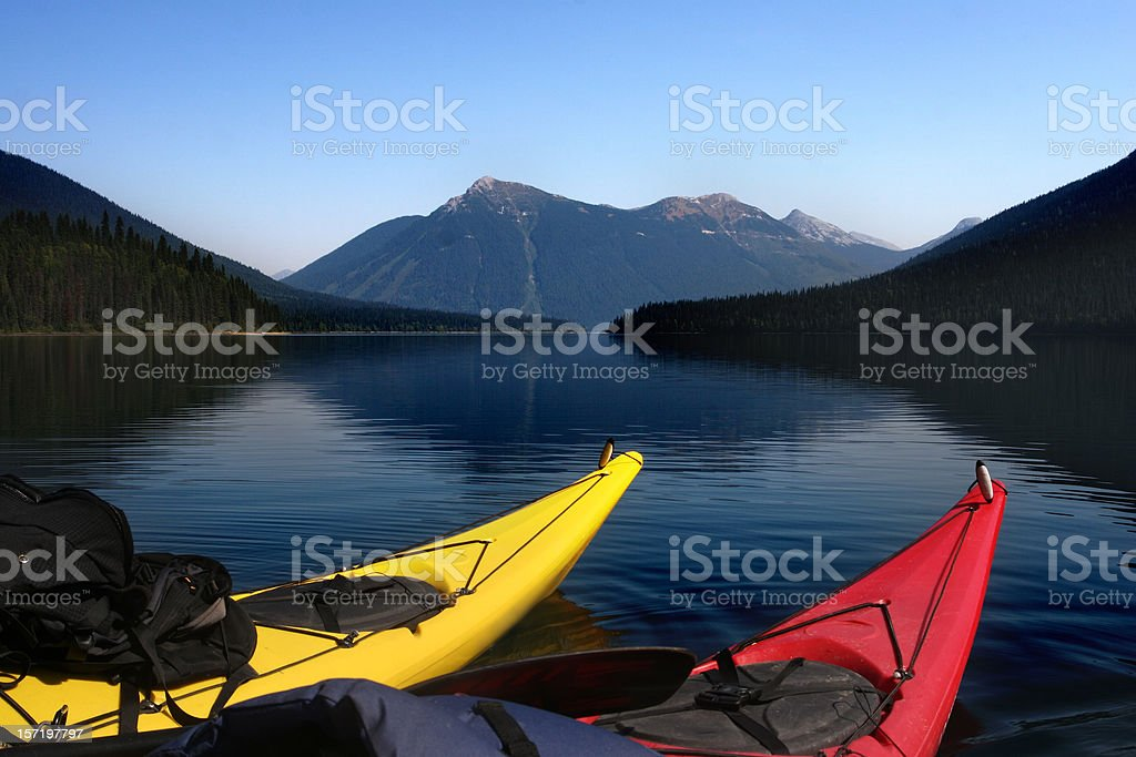 Two Kayaks and Mountain stock photo