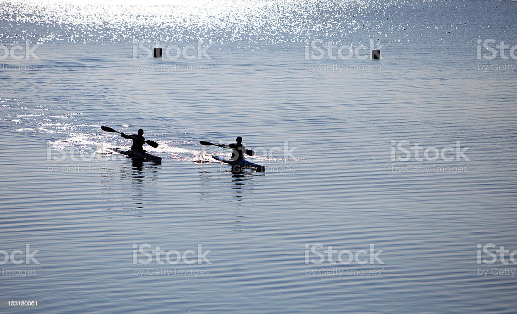 two kayaks on the evening workout royalty-free stock photo