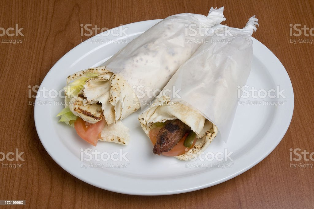 Two kebabs on a plate royalty-free stock photo