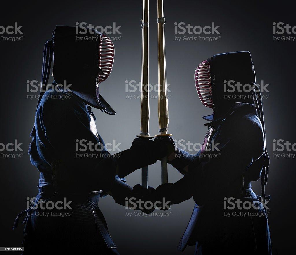 Two kendoka opposite each other stock photo