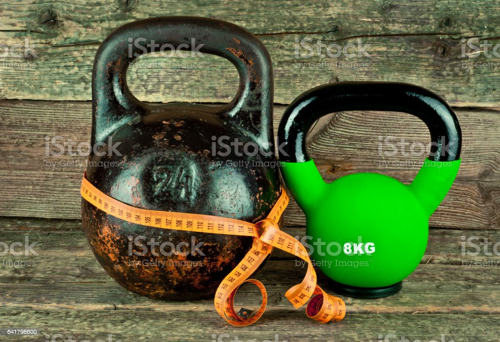 Two kettlebells on a wooden background stock photo