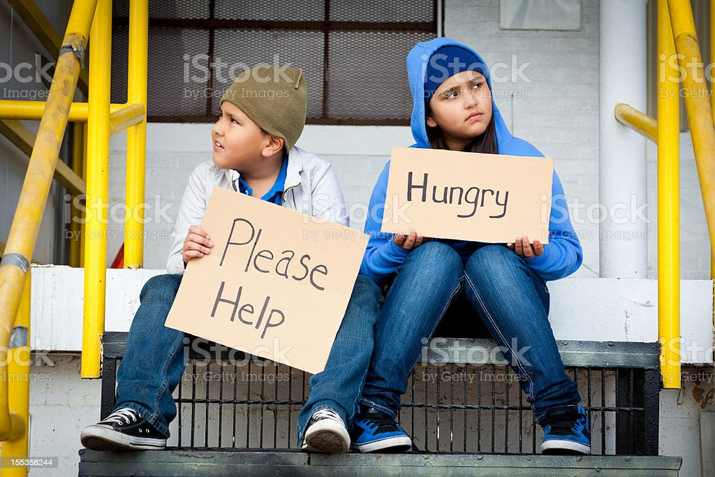 two kids asking for help royalty-free stock photo