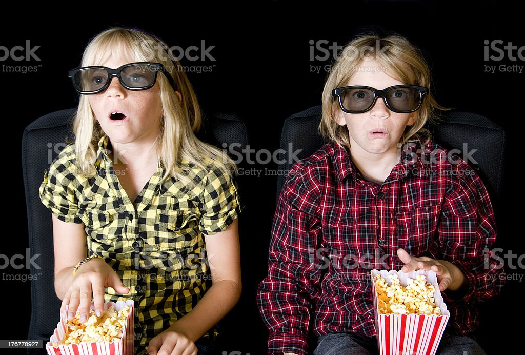 Two Kids at a Scary 3-D Movie royalty-free stock photo