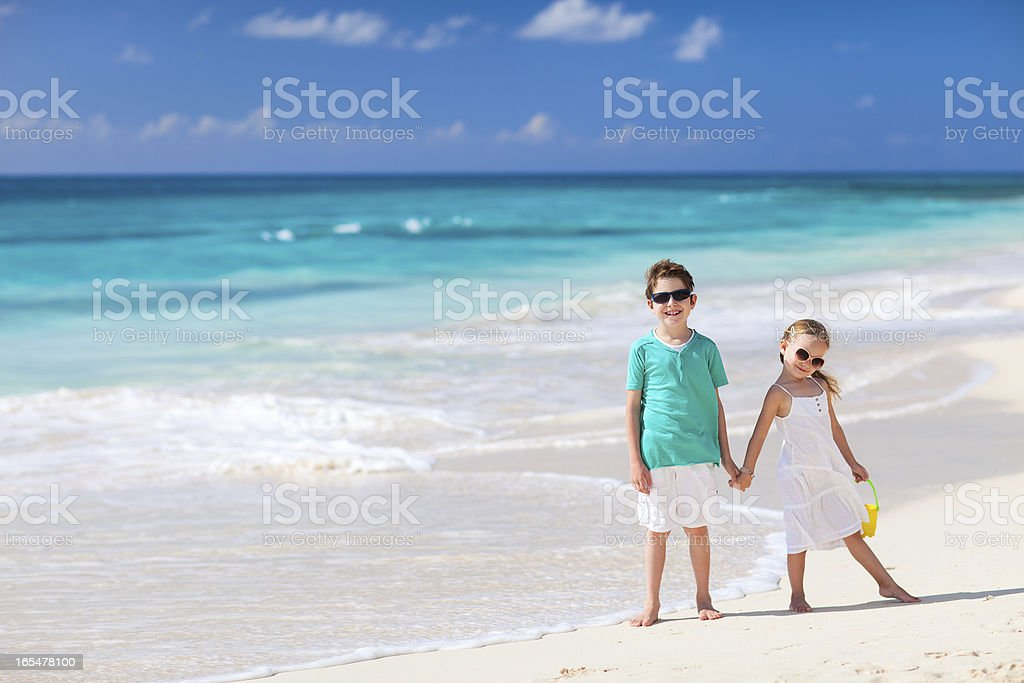 Two kids at beach royalty-free stock photo