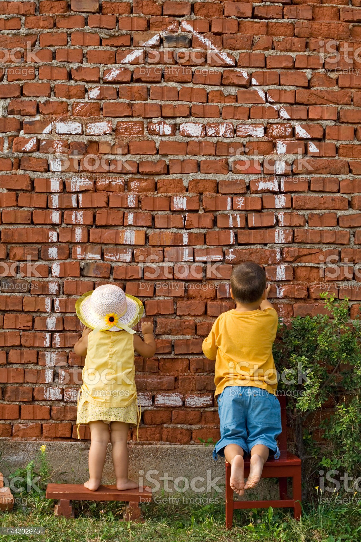 Two kids drawing a home royalty-free stock photo