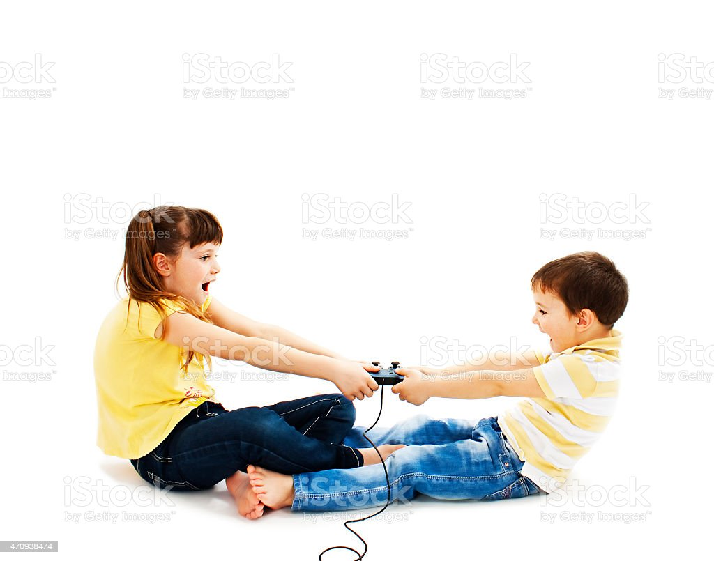 Two kids fighting stock photo