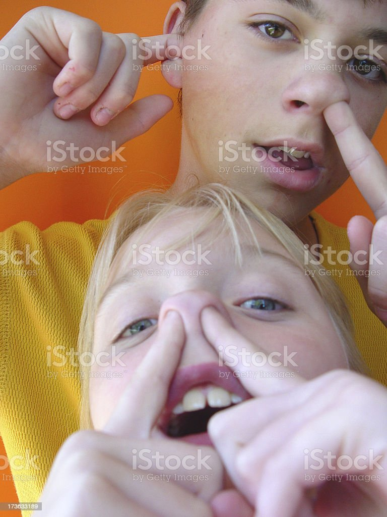 Two kids goofing around stock photo