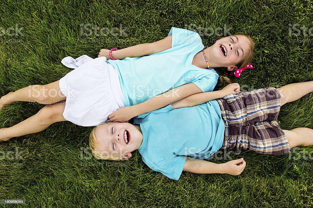 Two kids Laughing and having fun outdoors royalty-free stock photo