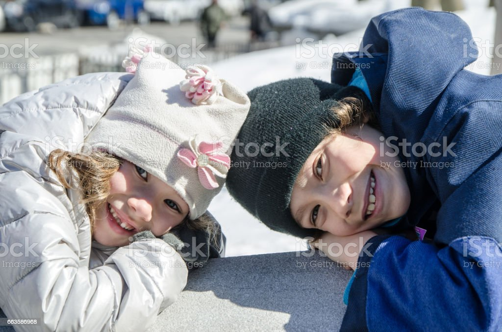 Two kids lying head to head stock photo