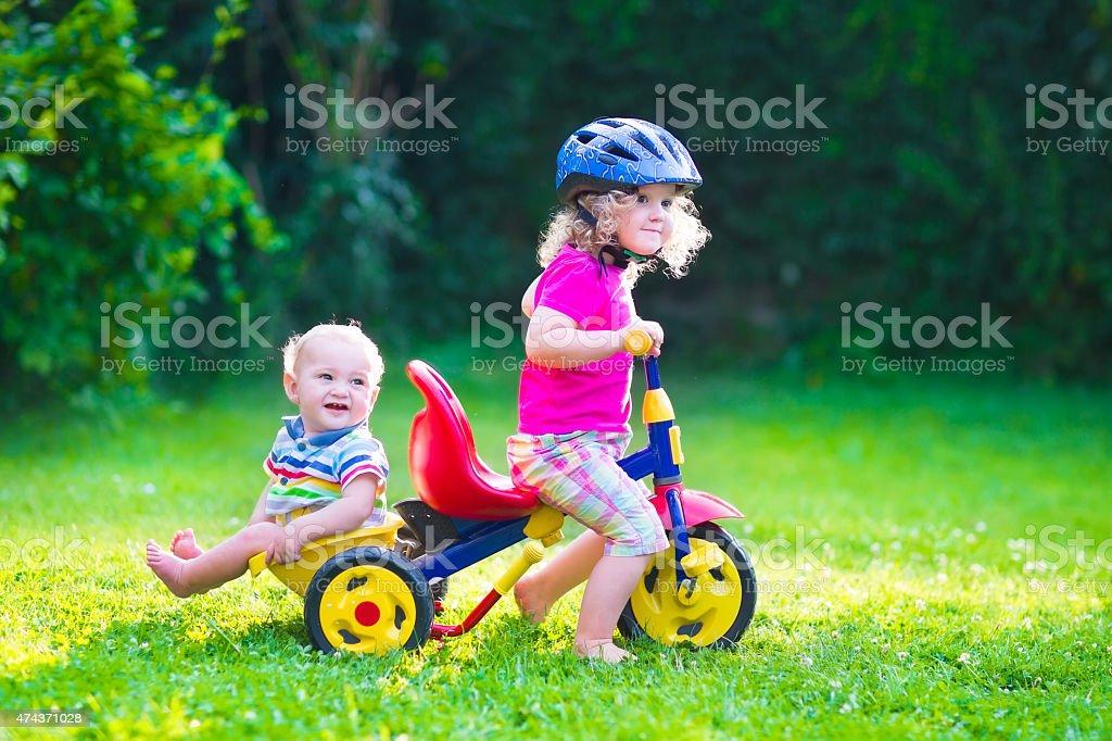 Two kids on a bike stock photo