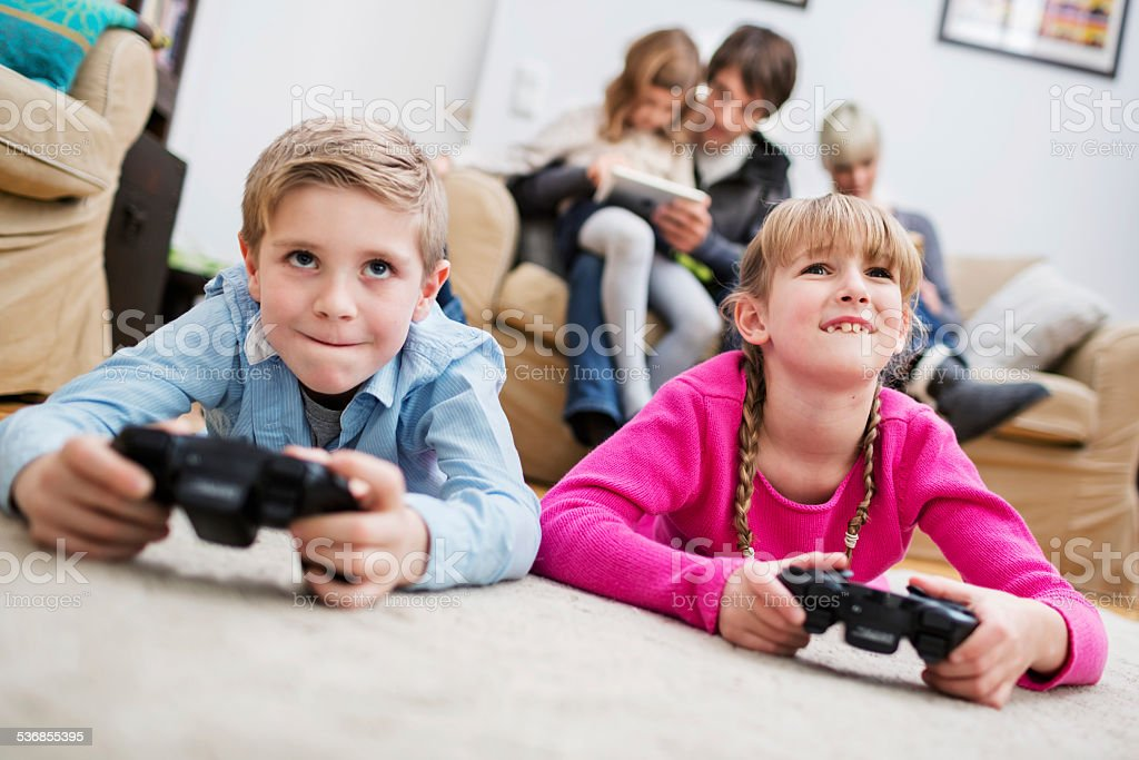 Two Kids Playing Game Console stock photo