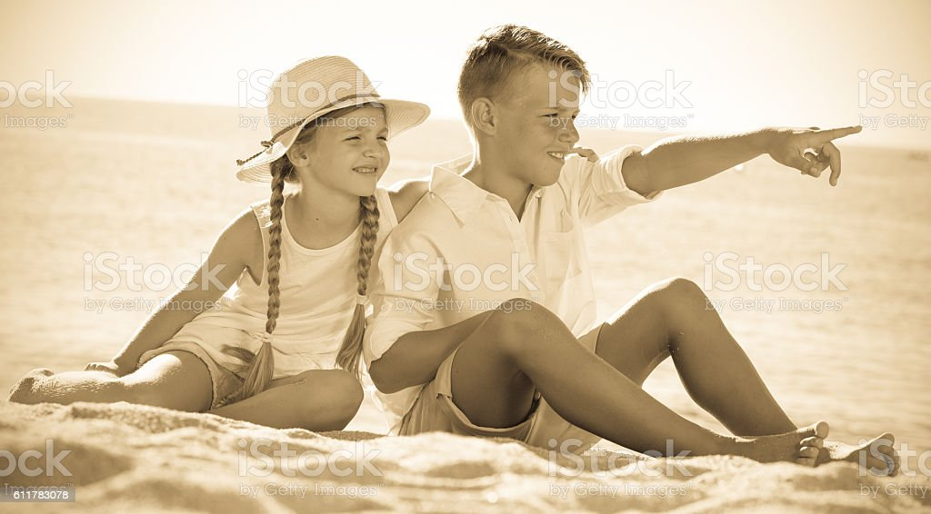 two kids pointing aside stock photo