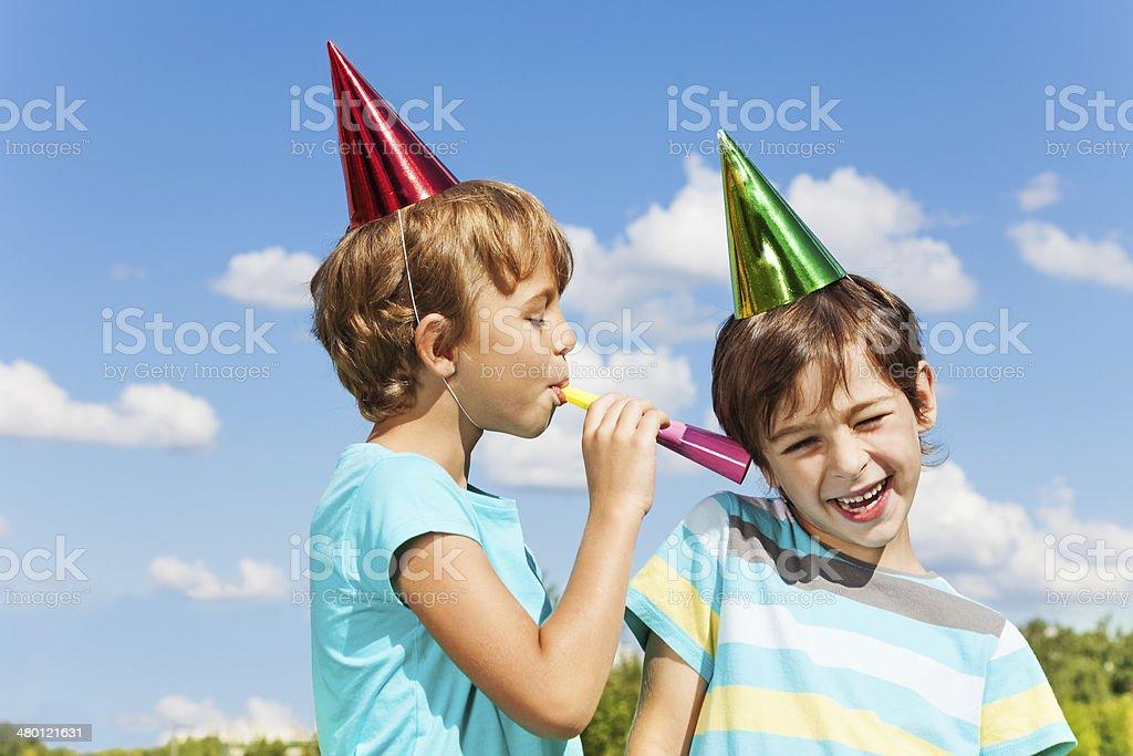 Two kids pranking stock photo