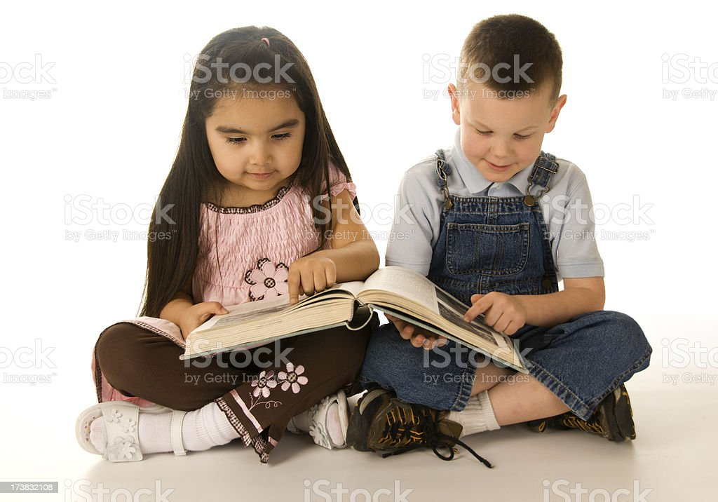 Two kids reading a book royalty-free stock photo