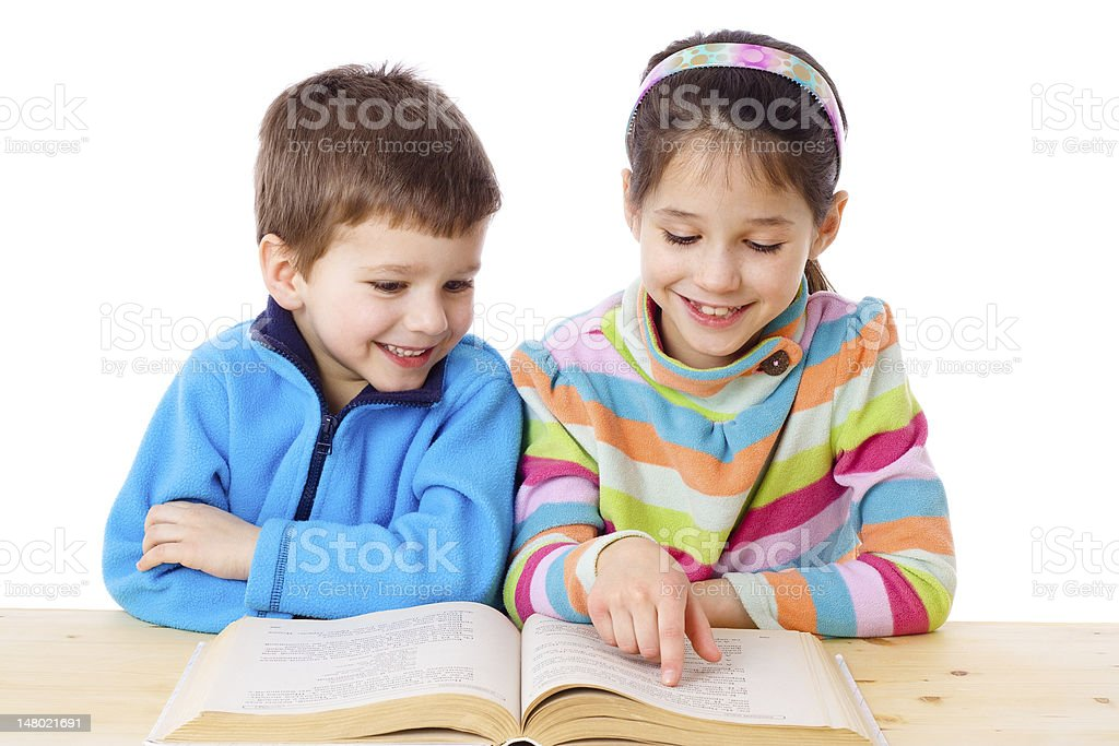 Two kids reading the book royalty-free stock photo