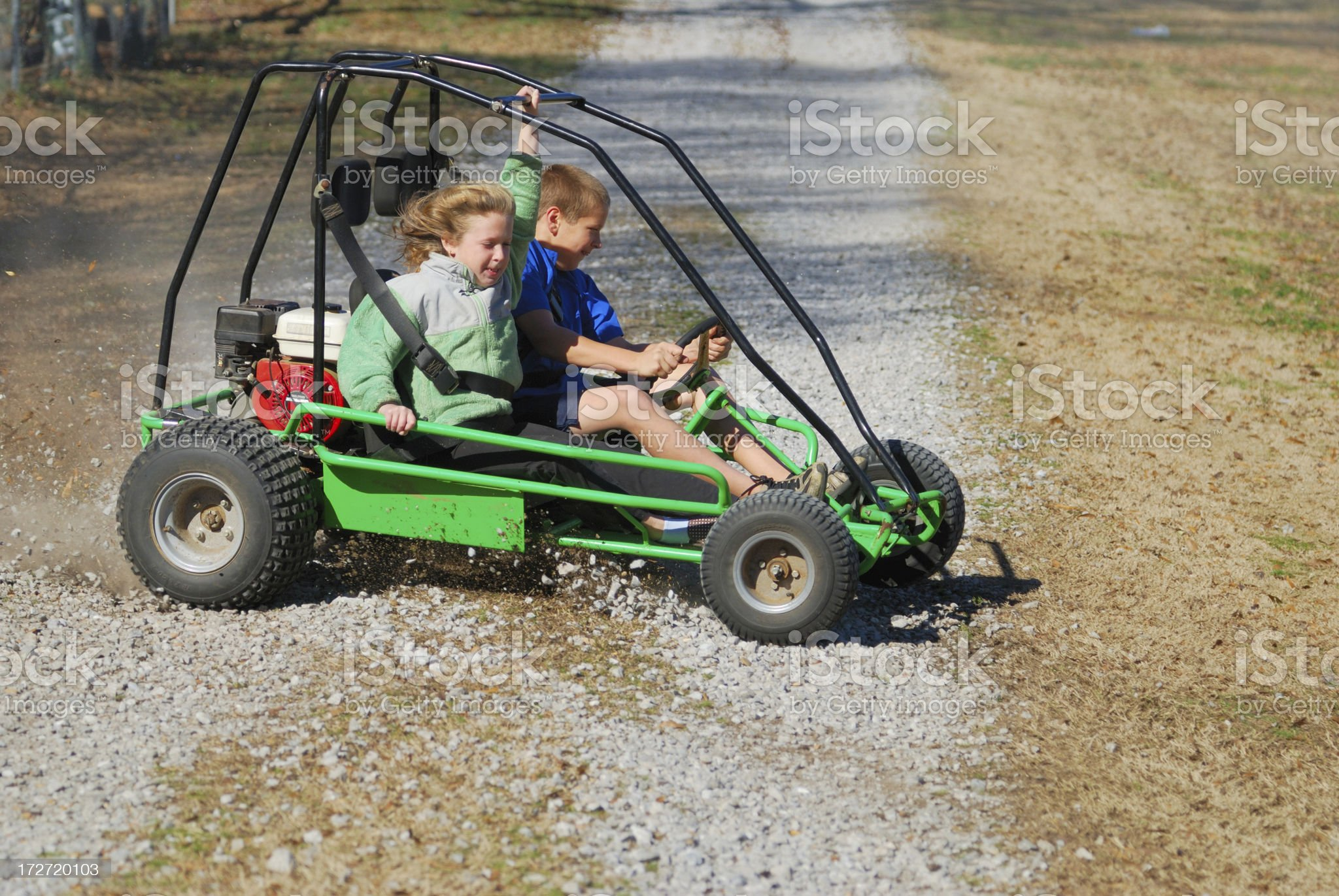 Two kids riding go cart royalty-free stock photo