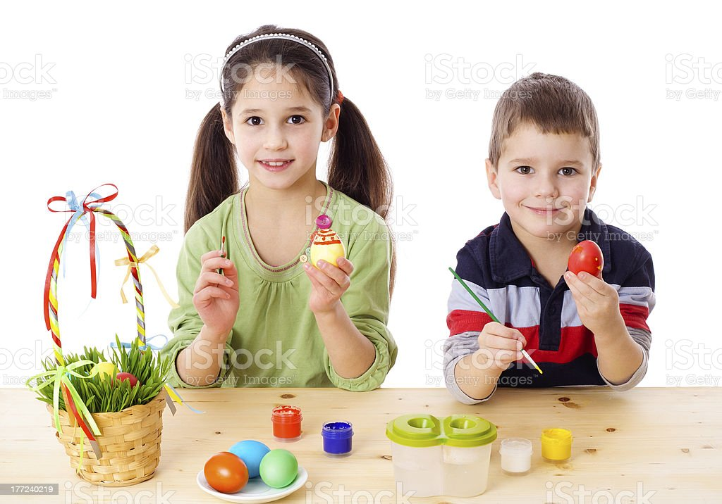 Two kids showing painted easter eggs royalty-free stock photo