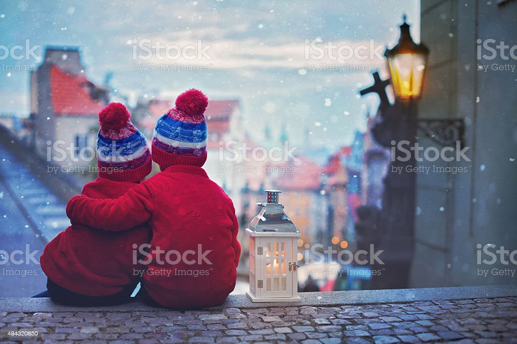 Two kids, standing on a stairs, holding a lantern stock photo
