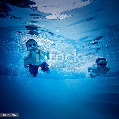 two kids swimming underwater stock photo 157527676 istock - Kids Swimming Underwater