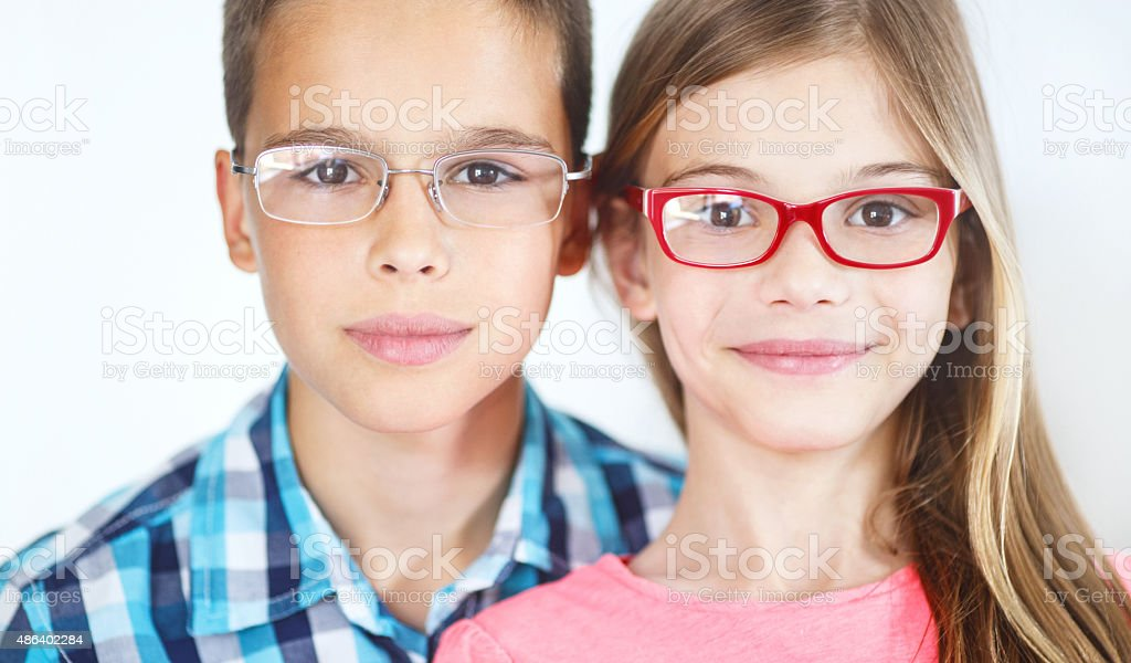 Two kids with eyeglasses. stock photo