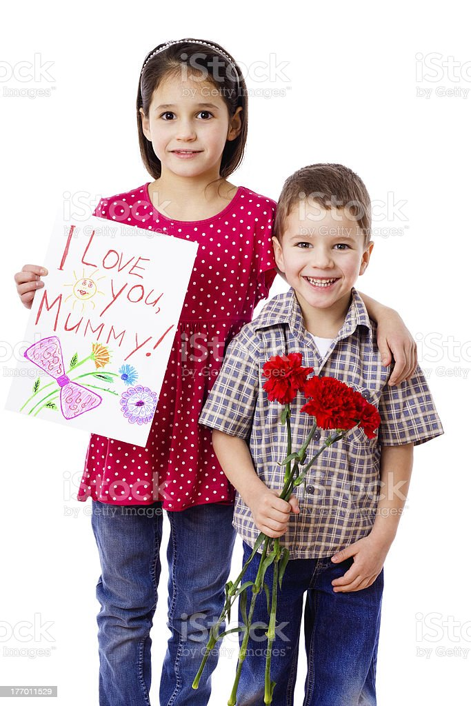Two kids with greetings for mum royalty-free stock photo