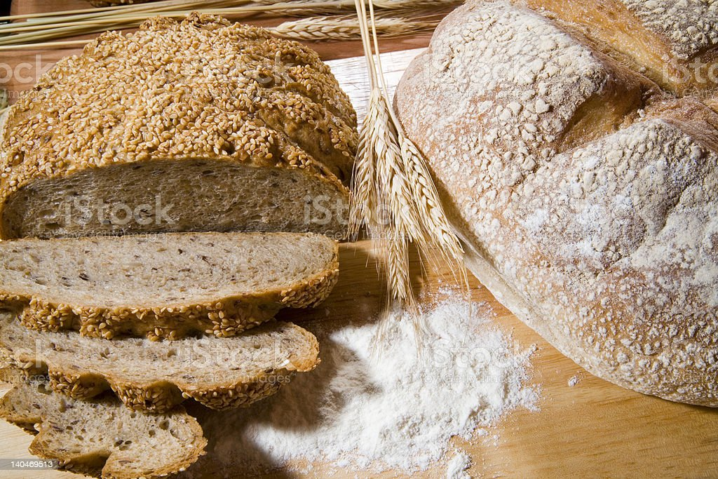 two kind of bread and a wheat royalty-free stock photo