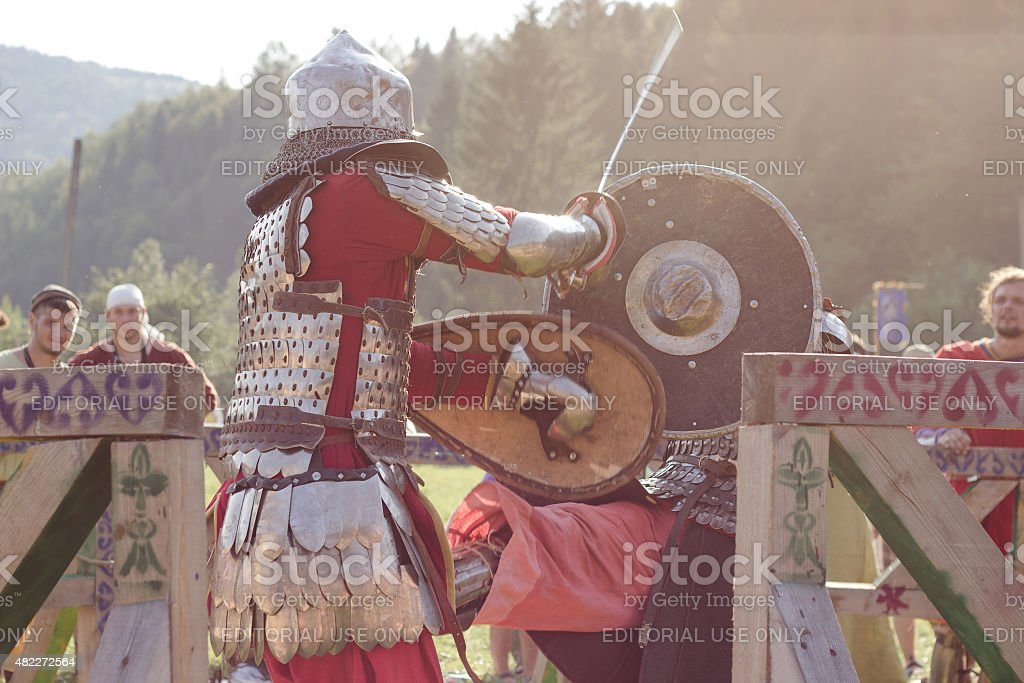 Two knights are fighting at Tustan' festival in Urych, Ukraine, stock photo