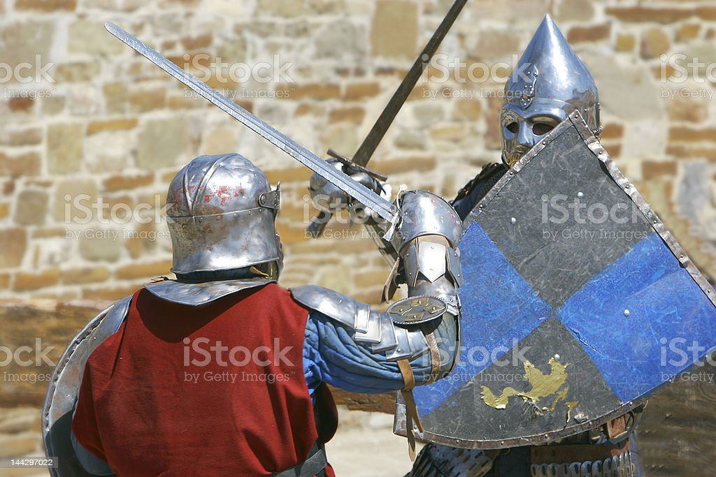 two knights fighting royalty-free stock photo