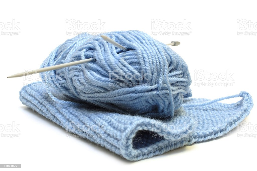 Two knitting needles  woollen yarn clew. royalty-free stock photo