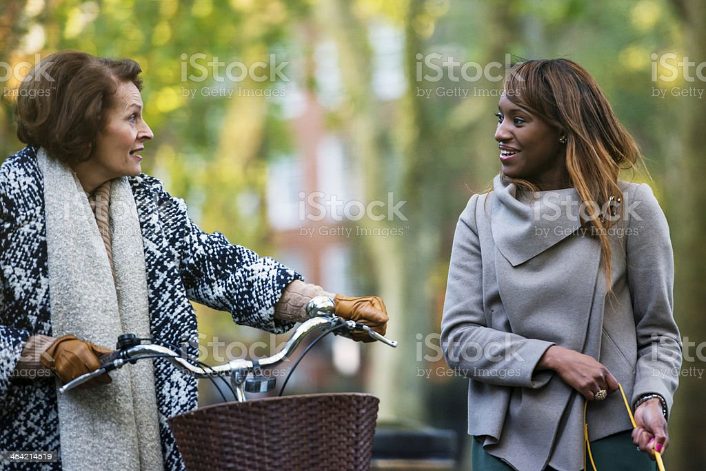 Two Ladies chatting in an Autumn Park royalty-free stock photo