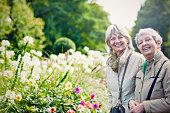Two ladies in city garden